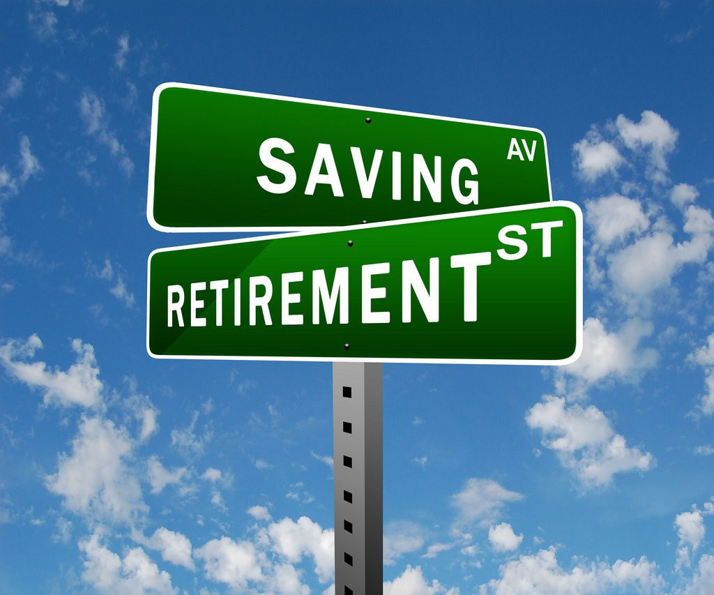 An image saying saving and retirement on street signs, showing that saving money is aligned to retiring.