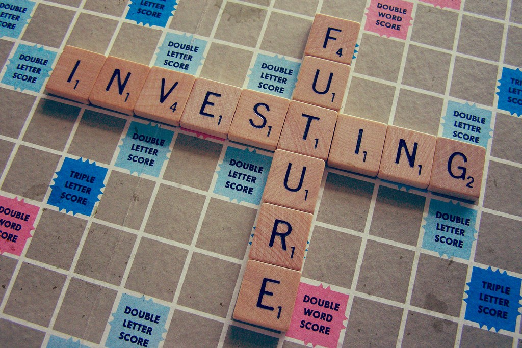 A Scrabble board showing future and investing overlapping. It's not hard to see how your retirement depends on your ability to invest money.