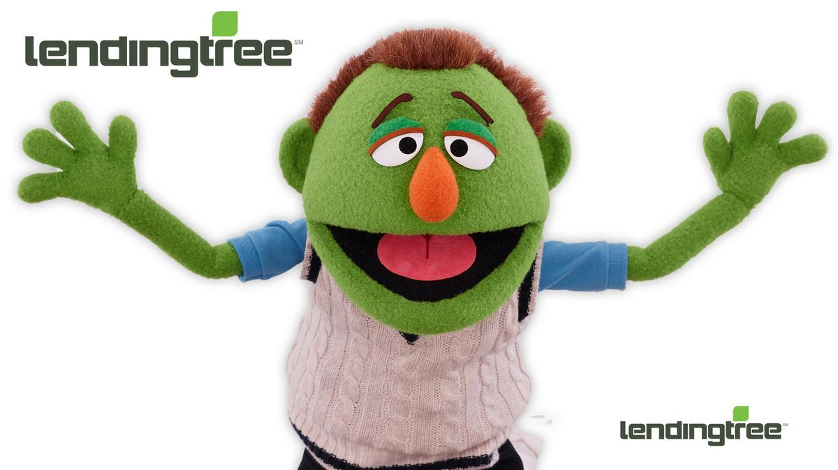 The logo and mascot for the company The Lending Tree. It helps reduce the costs of taking loans or mortgages.