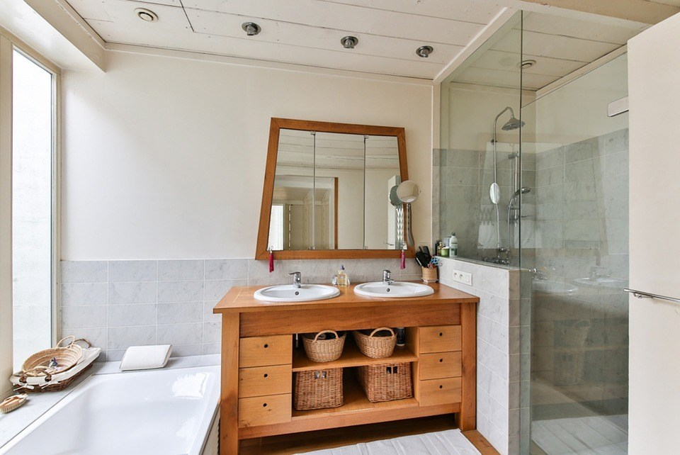 A picture of a bathroom. A frugal person saves a little money but gets a quality job done. A cheap person saves a lot, gets a bad job and then pays for it later.