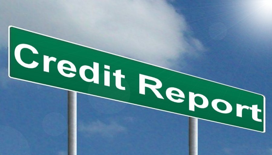 A signpost with Credit Report written on it in order to describe the main service provided by Credit.com for free.
