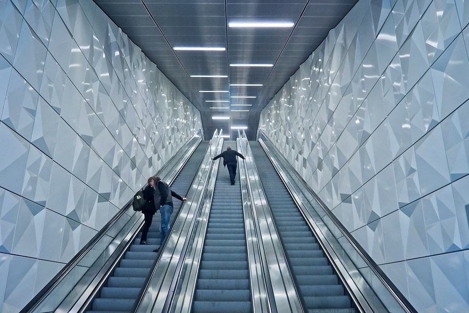 An escalator to symbolize how dividend growth investing keeps taking your returns higher and higher without any effort from you. A straightforward way to make money.