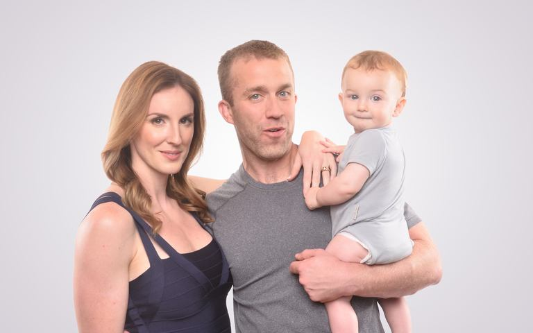This is a picture of Tucker Max with the important people in his life, he looks happy thanks to all the money he's made blogging.