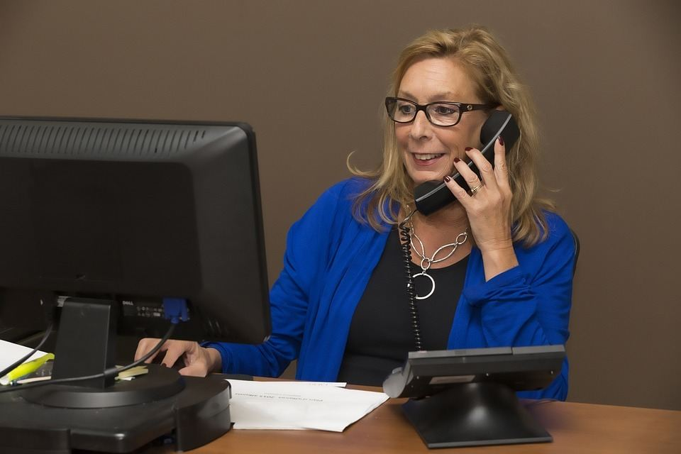 A virtual assistant works from home, just like a regular assistant (pictured here) works in an office.
