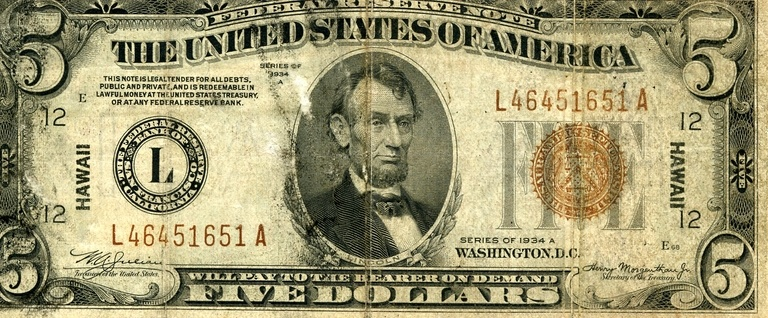 It's a $5 bill, you can't have this one though - it's from an emergency print run in 1934 and is no longer legal tender.