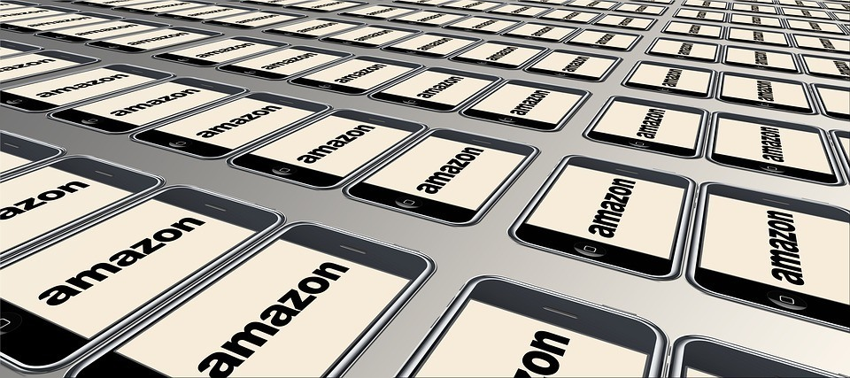 An image of smartphones with the Amazon logo showing. You can run an FBA business from a smartphone!