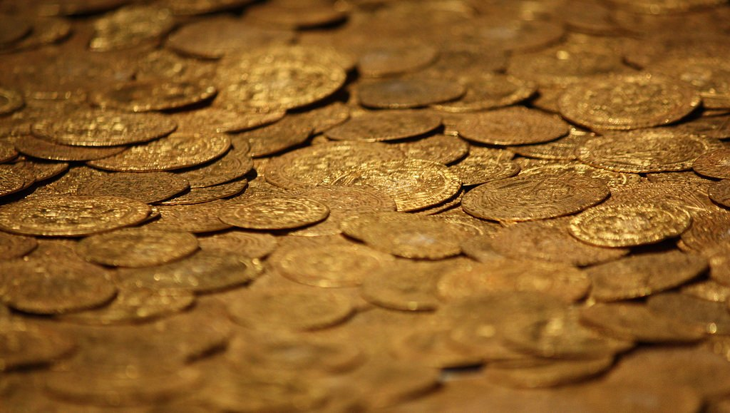 A big pile of coins. Turn your coins into cash using Coinstar or credit unions.