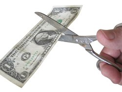 Someone using scissors on a dollar, not the way to reduce your costs we had in mind.