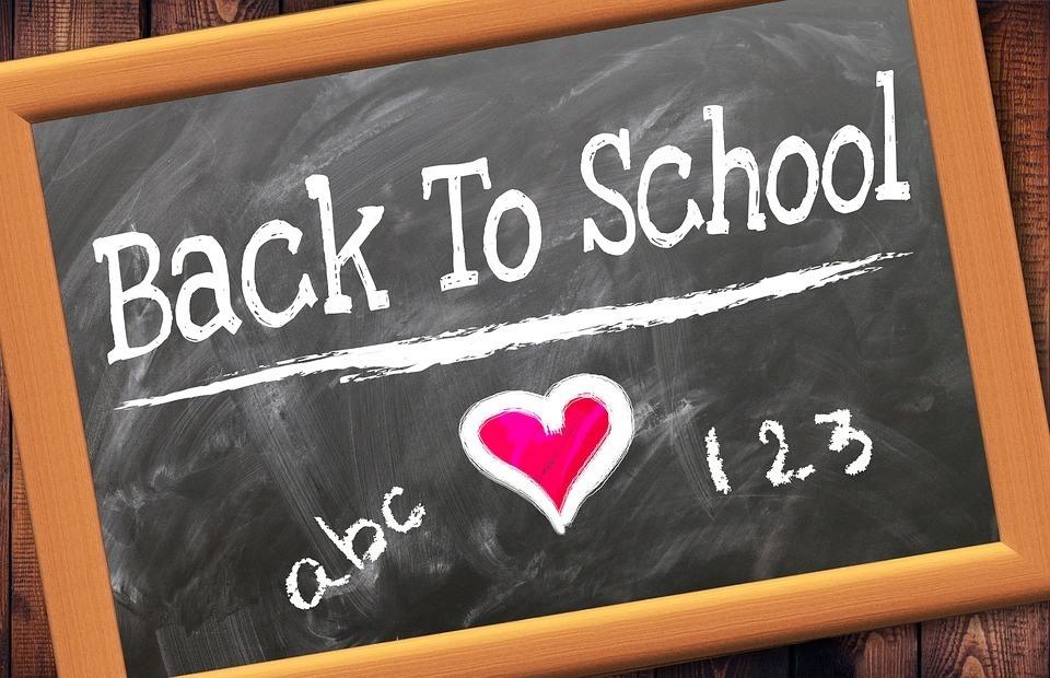 A blackboard with Back To School written on it. Save money.