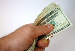 A fist full of cash. Make money through surveys.