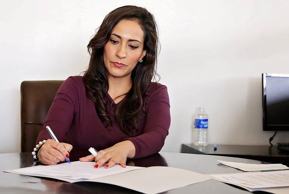 A woman working hard because bad debt is taking over her life.